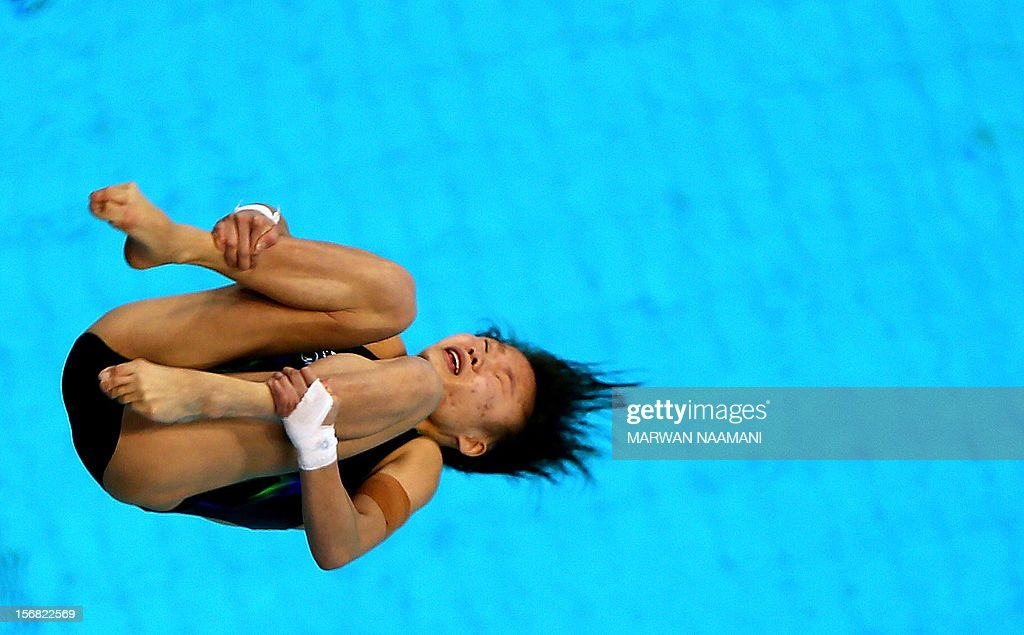 Shengping Wu of China performs in the women's 10m platform at the 9th Asian Swimming Championships in Dubai, on November 22, 2012. Shenping won the gold medal in the event. AFP PHOTO/MARWAN NAAMANI