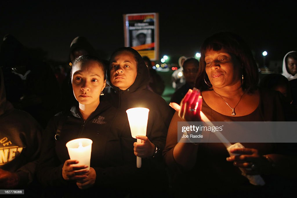 Shenika Mitchell and Yolanda Pearson (L-R) gather with others for a candle light vigil at Fort Mellon Park to mark the one year anniversary of when Trayvon Martin was killed on February 26, 2013 in Sanford, Florida. Martin was shot by George Zimmerman on February 26, 2012 while Zimmerman was on neighborhood watch patrol in the gated community of The Retreat at Twin Lakes in Sanford, Florida.