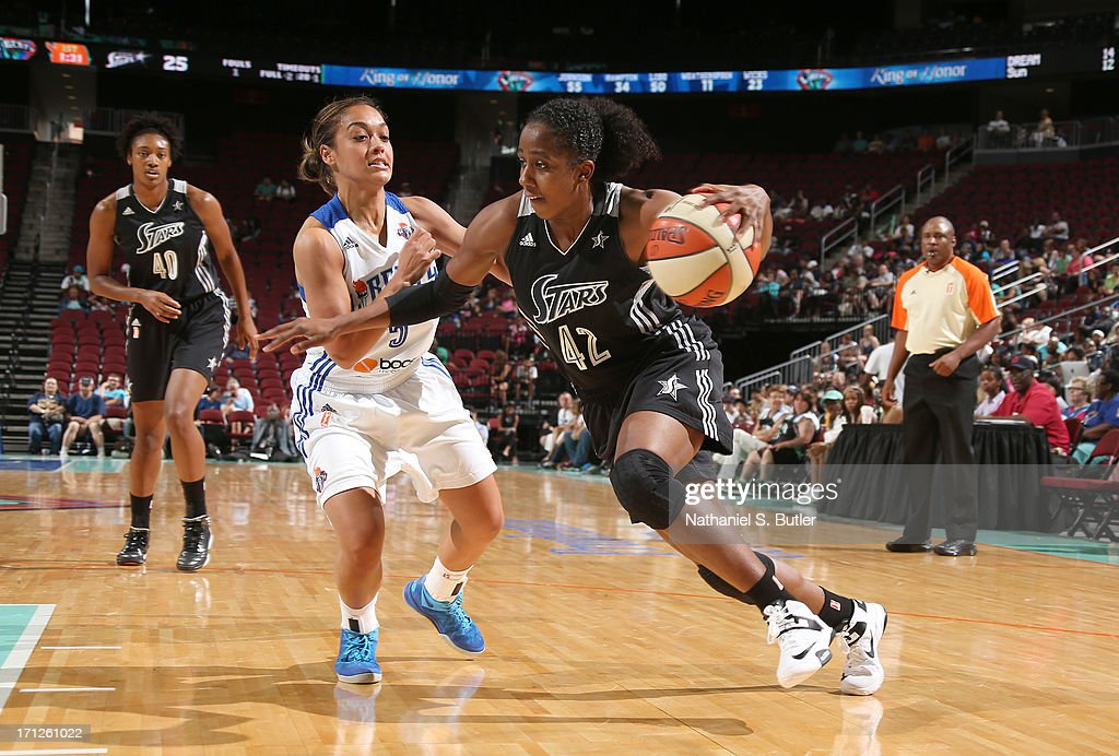 Shenise Johnson #42 of the San Antonio Silver Stars drives against Leilani Mitchell #5 of the New York Liberty during a game on June 23, 2013 at the Prudential Center in Newark, New Jersey.