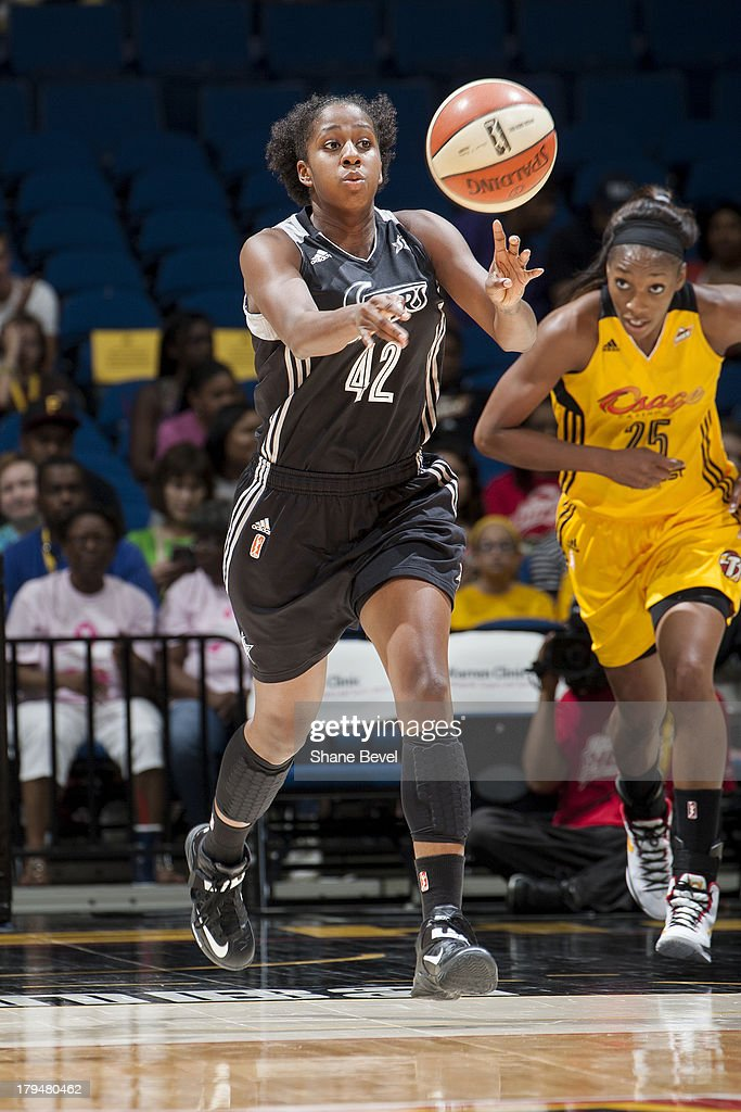 Shenise Johnson #42 of the San Antonio Silver Stars passes the ball up court against the Tulsa Shock during the WNBA game on August 30, 2013 at the BOK Center in Tulsa, Oklahoma.