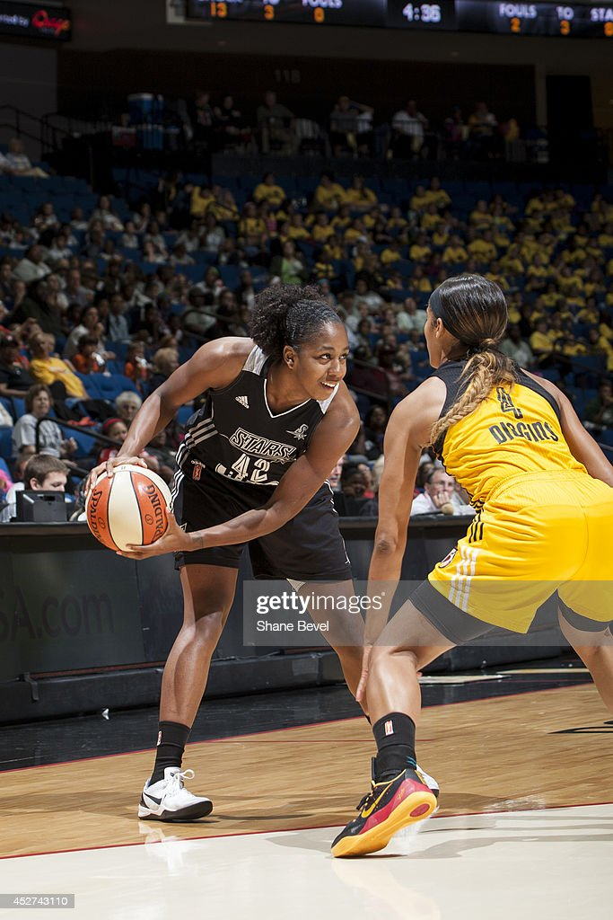 Shenise Johnson #42 of the San Antonio Stars controls the ball against the Tulsa Shock during the WNBA game on July 17, 2014 at the BOK Center in Tulsa, Oklahoma.