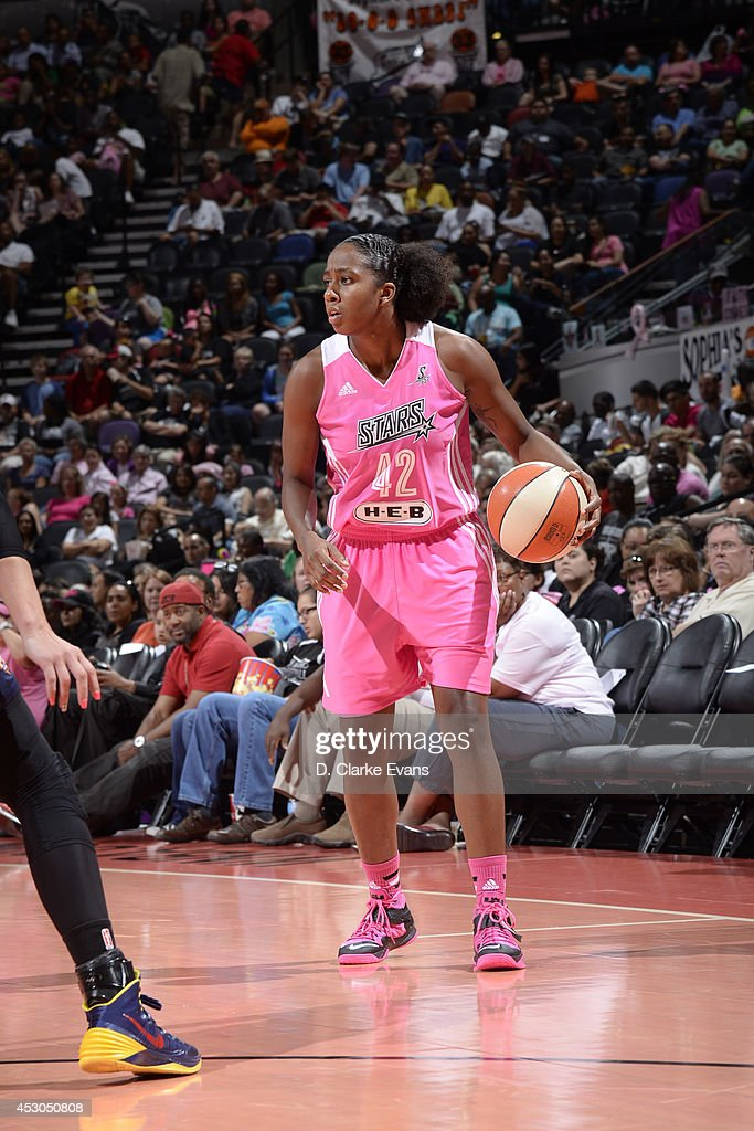 Shenise Johnson #42 of the San Antonio Stars handles the ball against the Connecticut Sun at the AT&T Center on August 1, 2014 in San Antonio, Texas.