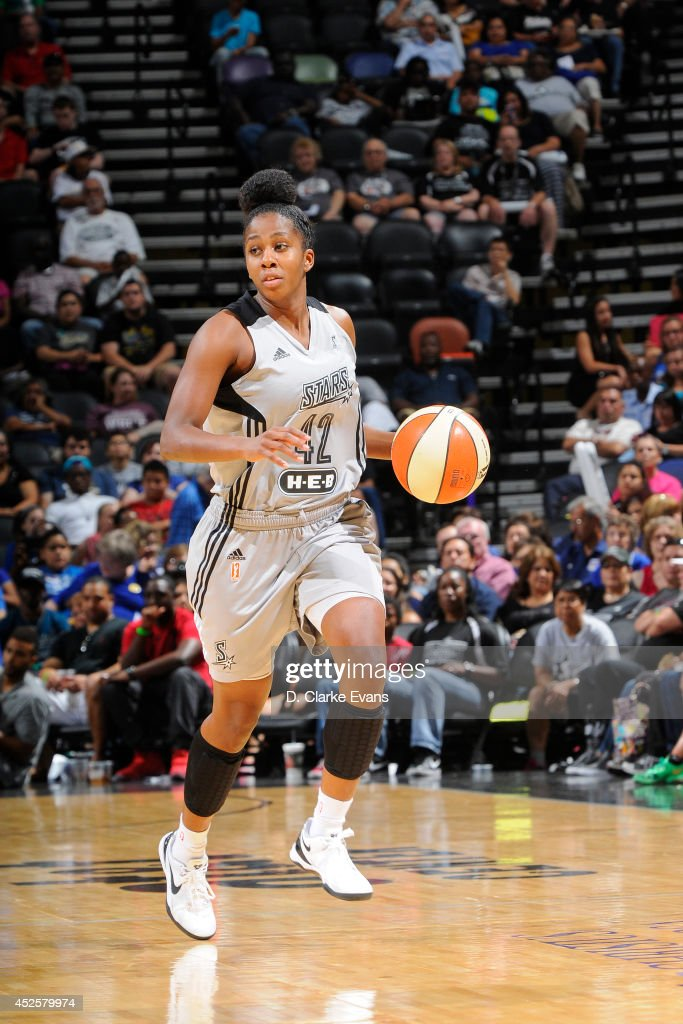 Shenise Johnson #42 of the San Antonio Stars moves the ball up-court against the Seattle Storm at the AT&T Center on July 11, 2014 in San Antonio, Texas.