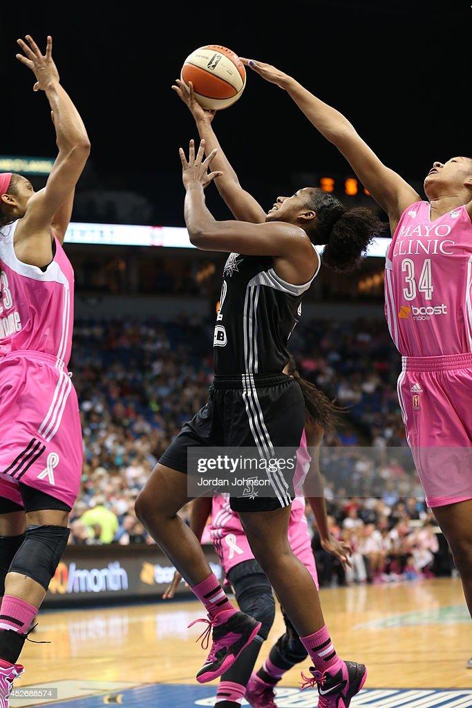 Shenise Johnson #42 of the San Antonio Stars shoots against Damiris Dantas #34 of the Minnesota Lynx during the WNBA game on July 25, 2014 at Target Center in Minneapolis, Minnesota.