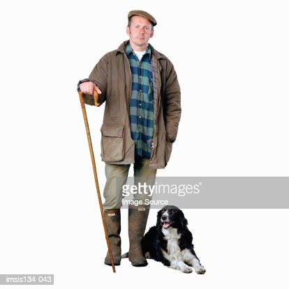 Shepherd with border collie dog : Stock Photo