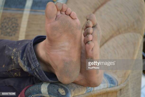 A shepherd's heels can be seen at a livestock market in the Yakacik area of Ankara Turkey on August 20 2017 Shepherds have brought their animals to...