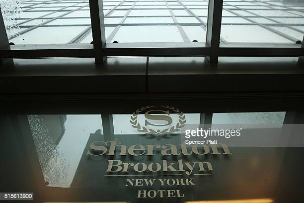 Sheraton Hotel sign stands in downtown Brooklyn on March 14 2016 in New York City A fight for the Starwood Hotel chain which Sheraton is a member of...
