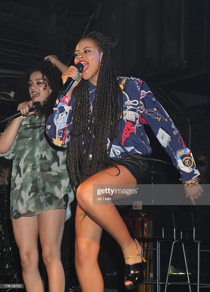 Shereen Cutkelvin and Amira McCarthy of Neon Jungle perform on stage at G-A-Y on August 31, 2013 in London, England.