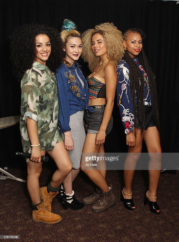 Shereen Cutkelvin, Asami Zdrenka, Jess Plummer and Amira McCarthy of Neon Jungle pose backstage at G-A-Y on August 31, 2013 in London, England.