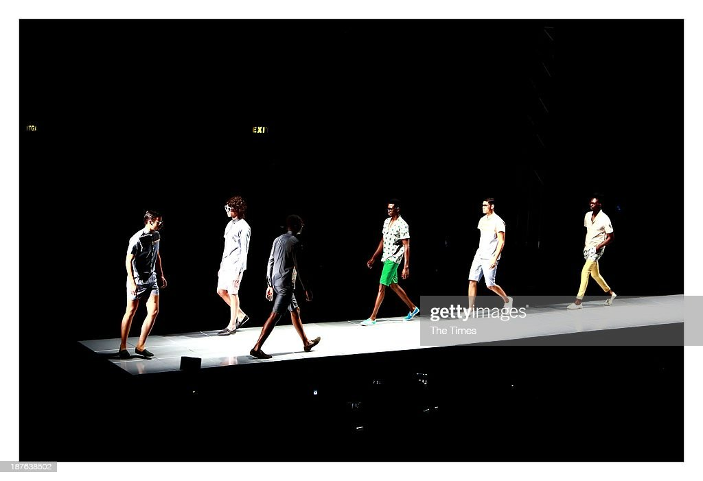 Sheria Ngowi and Laurence Airline's models take to the catwalk during the Mercedes-Benz Fashion Week on November 3, 2013 at the Pretoria City Hall in Pretoria, South Africa. The show took place in Pretoria for the first time over weekend, with David Tlale stealing the show by presenting his collection on a railway platform at the Ravos Rail Station.
