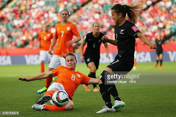 Sherida Spitse of Netherlands slides to save the ball from going out of bounds with pressure from Ali Riley of New Zealand during the FIFA Women's...