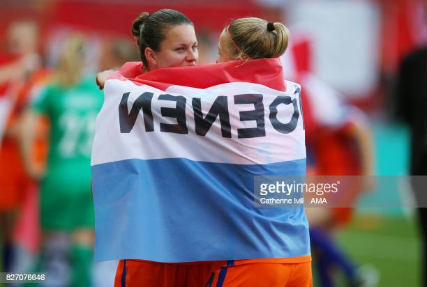 Sherida Spitse of Netherlands Women celebrates with a team mate after the UEFA Women's Euro 2017 final match between Denmark and Netherlands at De...