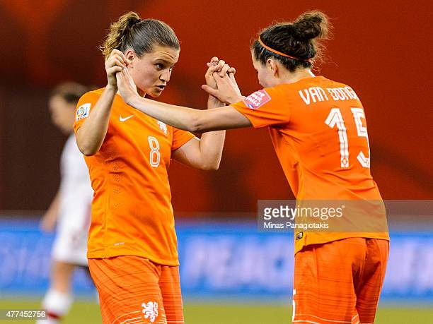Sherida Spitse of the Netherlands and teammate Merel Van Dongen congratulate one another during the 2015 FIFA Women's World Cup Group A match against...