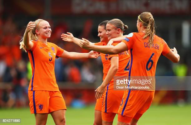 Sherida Spitse of the Netherlands celebrates victory with Mandy van den Berg and team mates during the UEFA Women's Euro 2017 Quarter Final match...