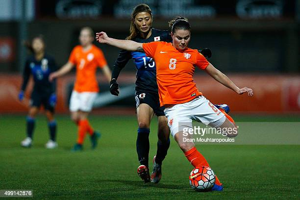 Sherida Spitse of the Netherlands clears the ball away from Rumi Utsugi of Japan during the International Friendly match between Netherlands and...