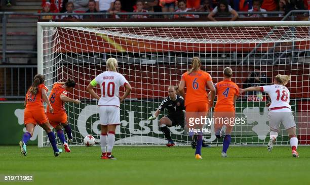 Sherida Spitse of The Netherlands scores the opening goal of the game during the UEFA Women's Euro 2017 Group A match between Netherlands and Denmark...