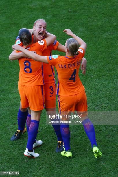 Sherida Spitse Stephanie van der Gragt and Mandy van den Berg of the Netherlands celebrate after winning the Netherlands v Denmark UEFA Women's Euro...