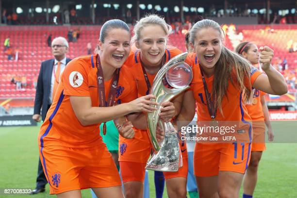 Sherida Spitse Vivianne Miedema and Lieke Martens of the Netherlands pose with the trophy following the Final of the UEFA Women's Euro 2017 between...