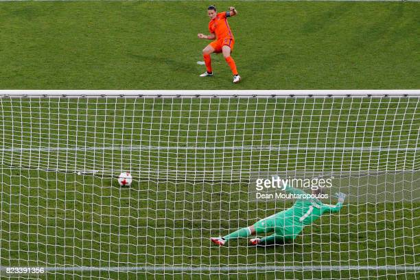 Sherida Spitseof Netherlands scores the opening goal from a penalty kick past goalkeeper Justien Odeurs of Belgium during the Group A match between...