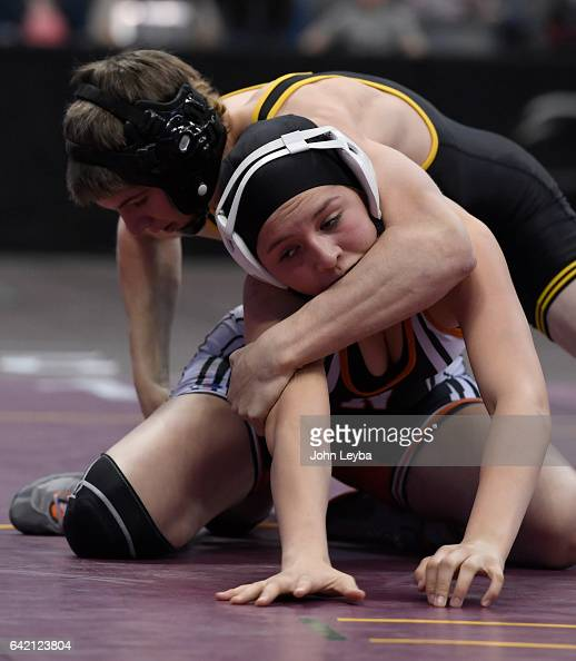 Sheridan Harvey of Meeker takes control of Natalie Benavides of Del Norte during their Class 2A 138 pound match at the Colorado high school state...