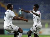Sherifatu Sumaila of Ghana celebrates victory over Japan with Priscilla Okyere during the FIFA U17 Women's World Cup 2012 QuarterFinal match between...