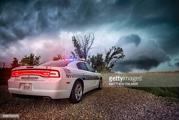 Sheriff car in storm
