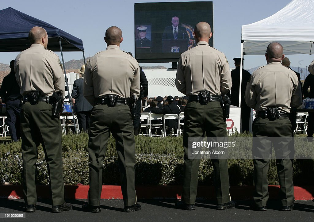 Sheriff Deputies stand together at the funeral for Riverside police Officer Michael Crain at Grove Community Church in Riverside, California, February 13, 2013. Officer Crain was allegedly killed by ex LAPD officer Chris Dorner on February 7, 2013.