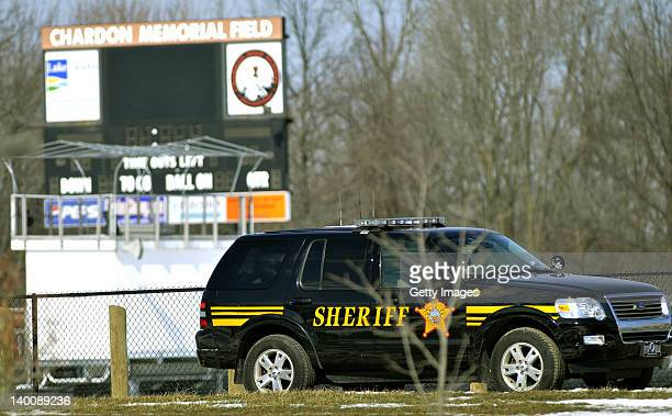 Sheriff deputy's vehicle is parked in front of the scoreboard to the football field at Chardon High School where a shooting took place on February 27...