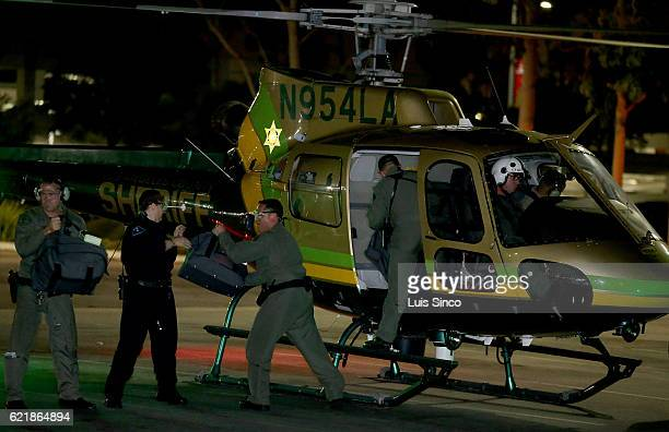 Sheriff's deputies unload bags of ballots from a helicopter at the LA County RegistrarRecorders office in Norwalk on election day on November 2016 in...