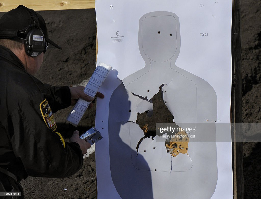 Sheriff's office firearms instructor Sgt. Harry Callithen prepares targets at the county gun range where retired state troopers are tested to be certified as part of the program to use retired state troopers to guard Butler schools in the wake of the Newtown, CT shootings. Photo by Michael S. Williamson/The Washington Post via Getty Images