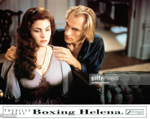 Sherilyn Fenn sits as Julian Sands holds her shoulders in a scene from the film 'Boxing Helena' 1993