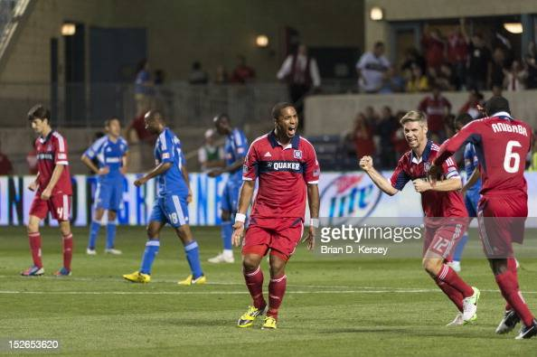 Sherjill MacDonald Logan Pause and Jalil Anibaba of Chicago Fire celebrate MacDonald's goal against the Montreal Impact at Toyota Park on September...