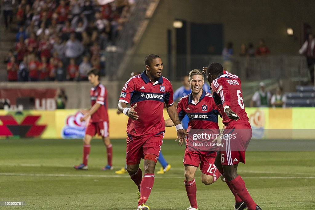 Sherjill MacDonald #7 (L-R), Logan Pause #12 and Jalil Anibaba #6 of Chicago Fire celebrate MacDonald's goal against the Montreal Impact at Toyota Park on September 15, 2012 in Bridgeview, Illinois. The Fire defeated the Impact 3-1.