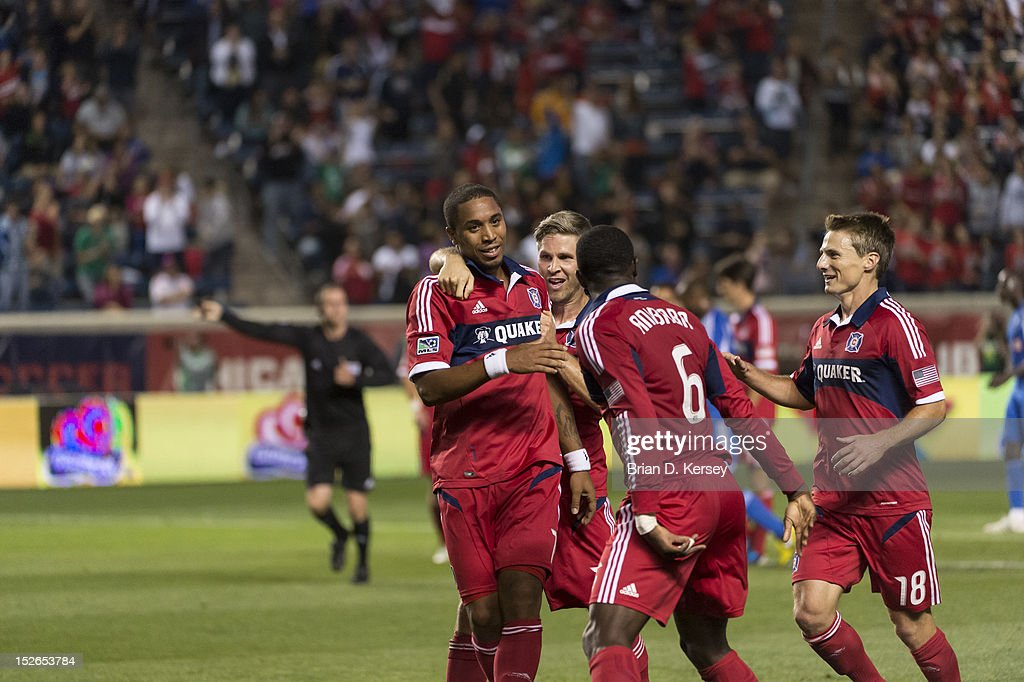Sherjill MacDonald #7 (L-R), Logan Pause #12, Jalil Anibaba #6 and Chris Rolfe #18 of Chicago Fire celebrate MacDonald's goal against the Montreal Impact at Toyota Park on September 15, 2012 in Bridgeview, Illinois. The Fire defeated the Impact 3-1.