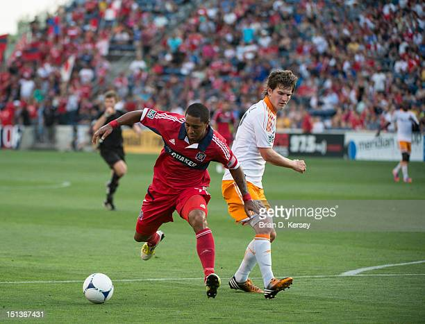 Sherjill MacDonald of Chicago Fire moves the ball as Will Bruin of Houston Dynamo defends at Toyota Park on September 2 2012 in Bridgeview Illinois...