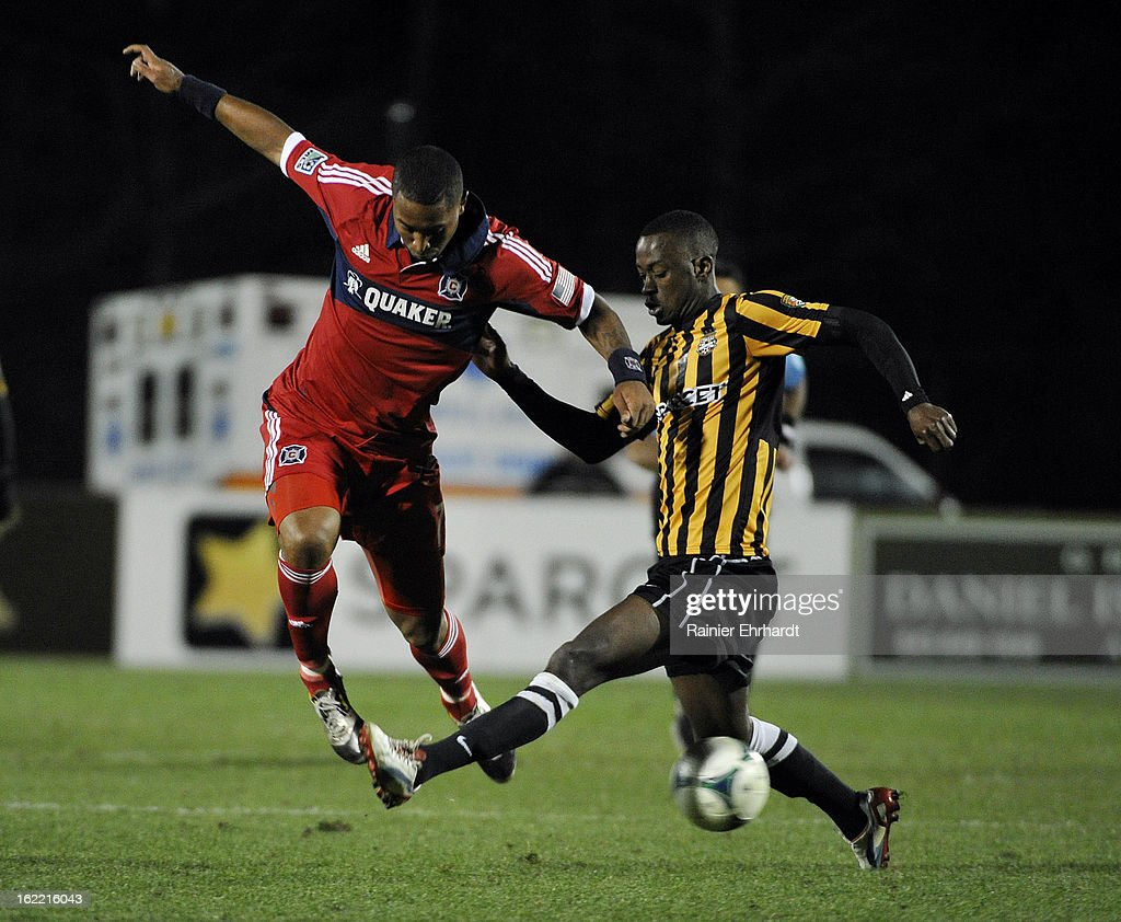 Sherjill MacDonald #7 of the Chicago Fire and Amadou Sanyang #23 of the Charleston Battery battle for the ball during the first half of a game at Blackbaud Stadium on February 20, 2013 in Charleston, North Carolina.