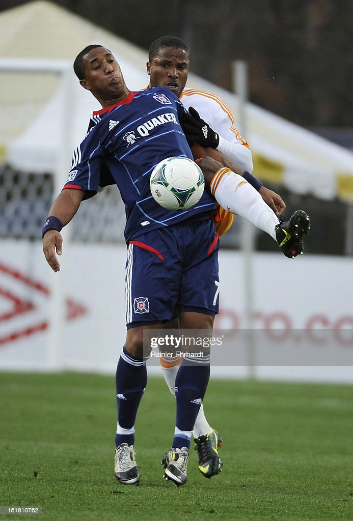 Sherjill MacDonald #7 of the Chicago Fire and <a gi-track='captionPersonalityLinkClicked' href=/galleries/search?phrase=Jermaine+Taylor+-+Soccer+Player&family=editorial&specificpeople=13524207 ng-click='$event.stopPropagation()'>Jermaine Taylor</a> #4 of the Houston Dynamo fight for the ball during the first half of their game in the Carolina Challenge Cup at Blackbaud Stadium on February 16, 2013 in Charleston, South Carolina.