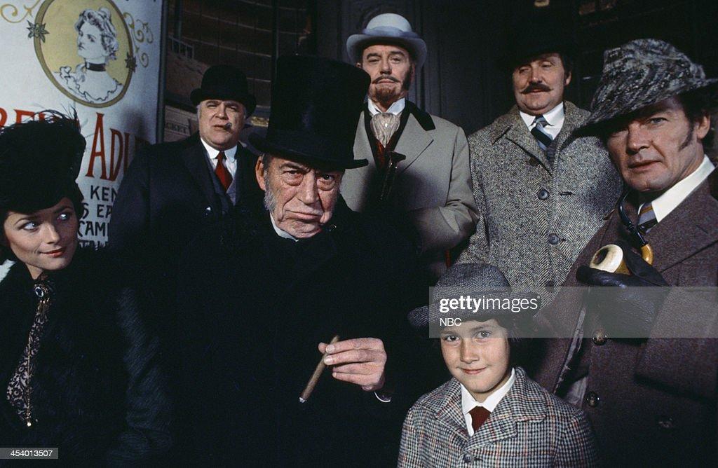 MOVIES -- 'Sherlock Holmes in New York' -- Pictured: (l-r) Charlotte Rampling as Irene Adler, David Huddleston as Inspector Lafferty, John Huston as Professor Moriarty, Gig Young as Mortimer McGraw, Geoffrey Moore as Scott Adler, Patrick Macnee as Doctor Watson, Roger Moore as Sherlock Holmes --