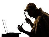 Sherlock Holmes laptop computer silhouette in studio on white background