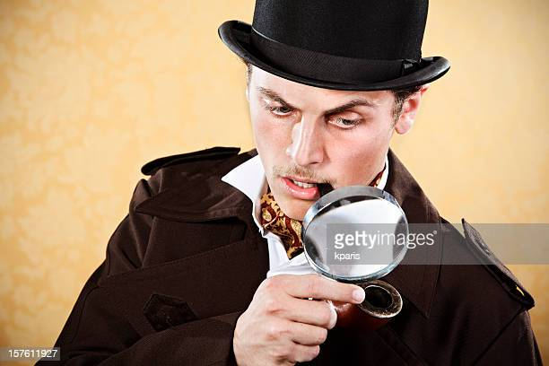 Sherlock Holmes with hat, trenchcoat, and magnifying glass