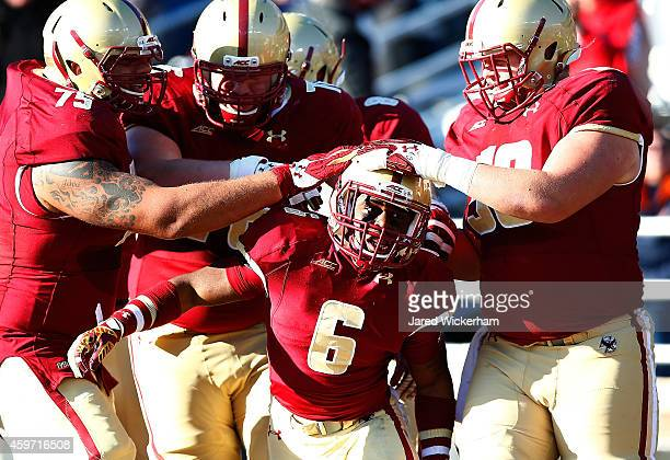 Sherman Alston of the Boston College Eagles celebrates with his teammates following his touchdown catch in the second quarter against the Syracuse...