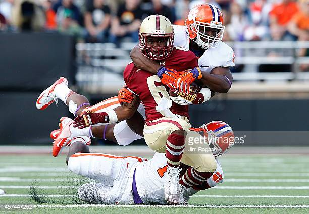 Sherman Alston of the Boston College Eagles is brought down by Tony Steward of the Clemson Tigers in the first half against the Clemson Tigers at...