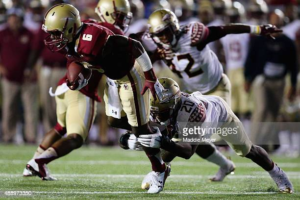 Sherman Alston of the Boston College Eagles is tackled by Trey Marshall of the Florida State Seminoles during the second half at Alumni Stadium on...