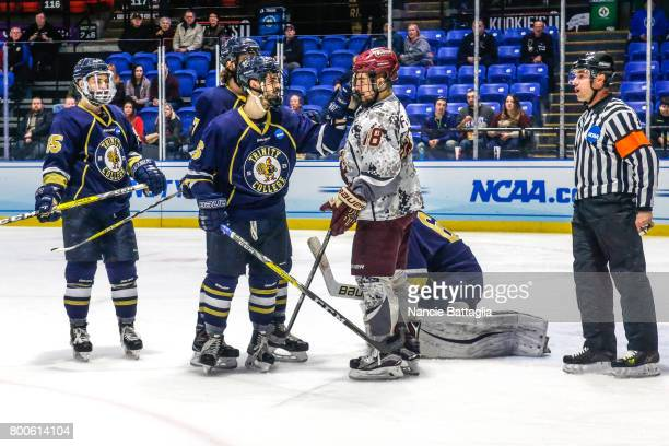 TJ Sherman of Trinity College and Charlie Zuccarini of Trinity College get in each others' faces during the Division lll Men's Ice Hockey...