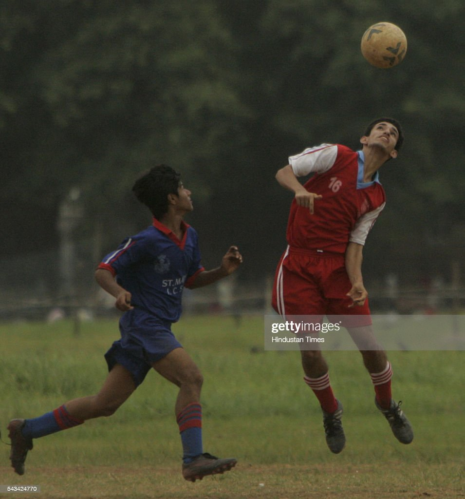 Sheroy Khan (red) of campion school and Ronal Shah (blue) of St. Marys ICSE fighting for the ball during MSSA boys u-16 div-i-pol football match at azad maidan on August 31, 2005.