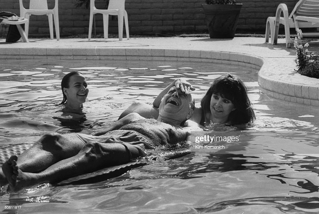 Sherri Chessen Finkbine (R) in swimming pool w. daughter Kristin & her present husband David Pent who is lying on a rubber raft at home; Chessen suffered the plight of a pariah for 30 yrs. after she obtained a Swedish abortion for her thalidomide-damage.d fetus