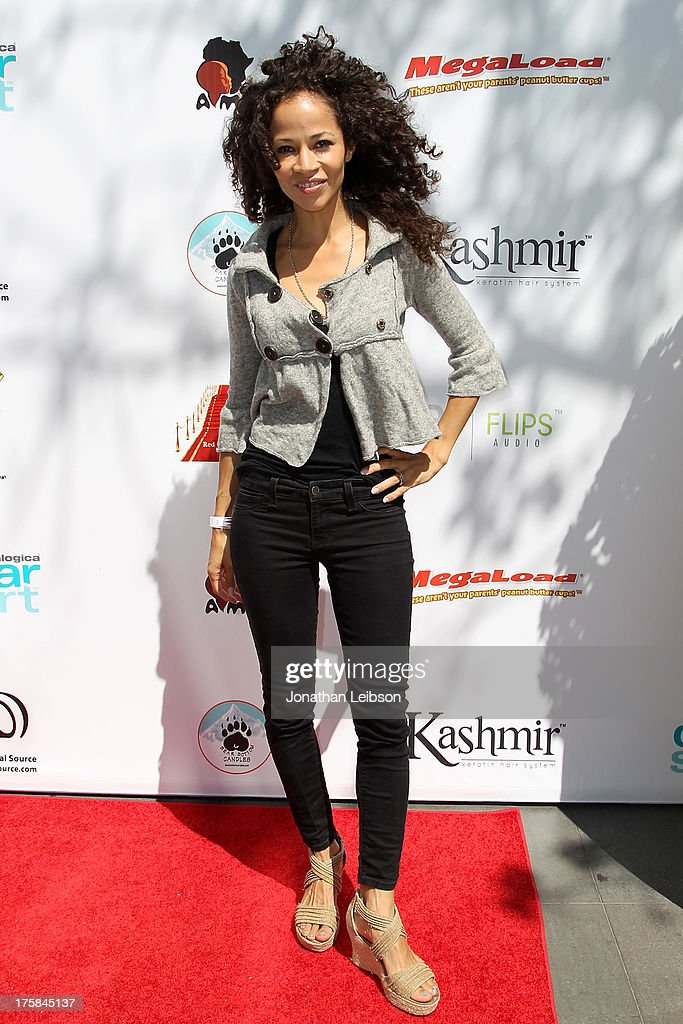 Sherri Saum attends the Red Carpet Events LA Teen Choice Style Lounge on August 8, 2013 in Beverly Hills, California.