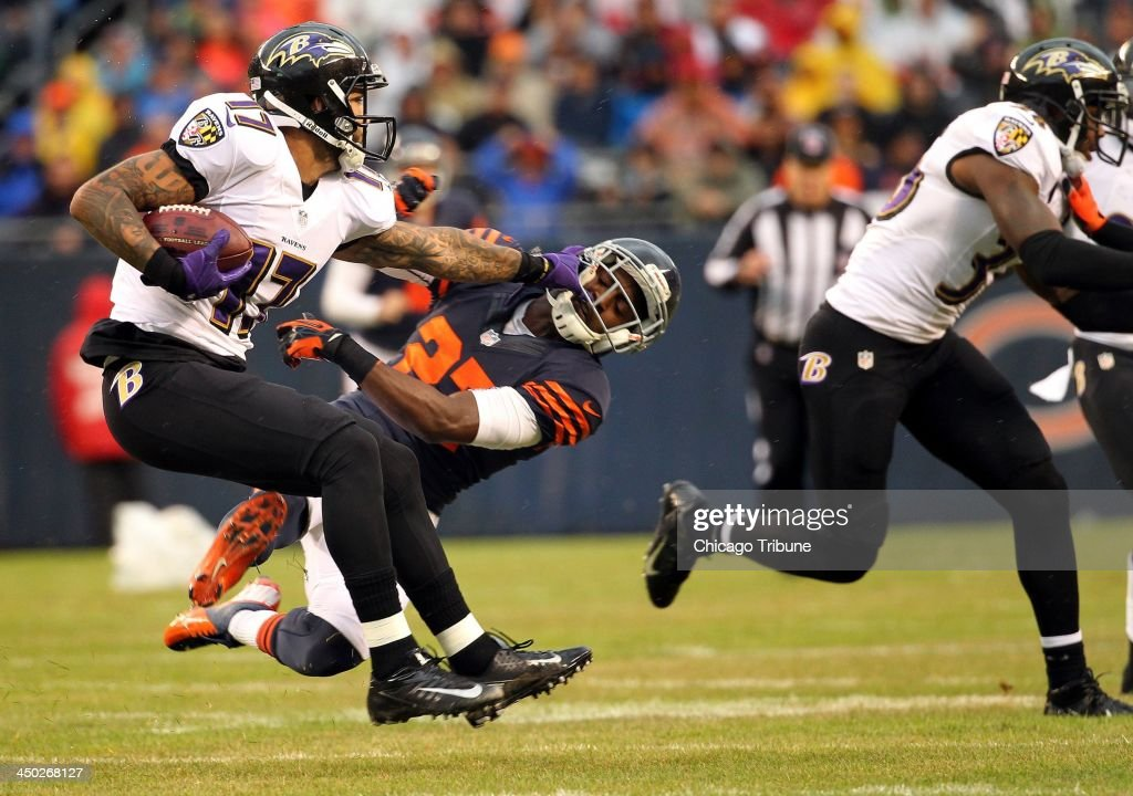 Sherrick McManis (27) of the Chicago Bears tries to take down Tandon Doss (17) of the Baltimore Ravens during the first quarter at Soldier Field in Chicago on Sunday, Nov. 17, 2013.