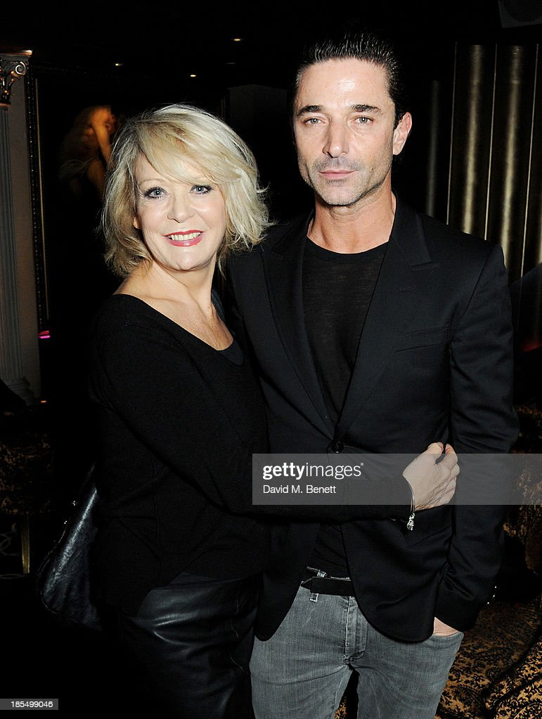Sherrie Hewson (L) and Jake Canuso attend the launch of Joan Collins new book 'Passion For Life' at No.41 Mayfair Club at The Westbury Hotel on October 21, 2013 in London, England.