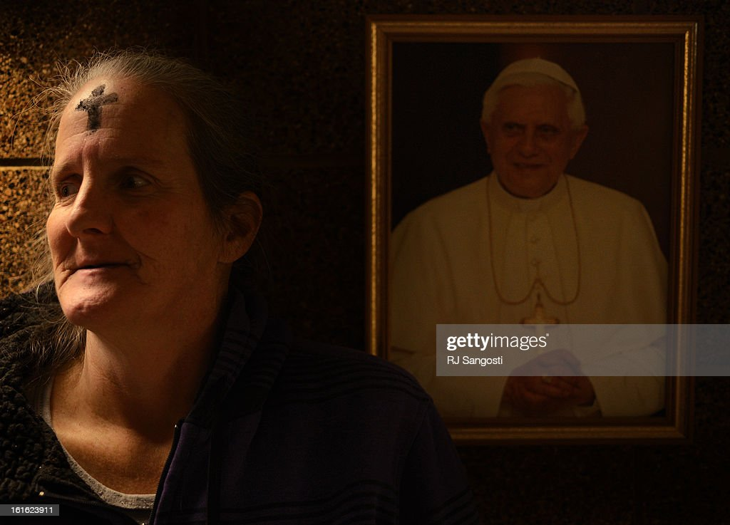 Sherry Fitzwater, took part in the practice of receiving ashes during the Ash Wednesday Mass at the St. Francis Chapel in the Samaritan House Homeless Shelter, February, 13, 2013. Fitzwater has been living in the shelter for the past eight months. A photo of Pope Benedict XVI hangs on the wall in the shelter.